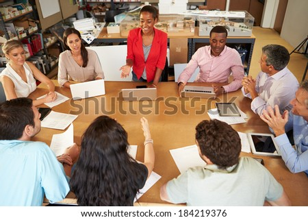 Architects Sitting At Table Meeting With Laptops And Tablets - stock photo