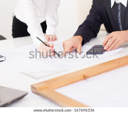 Architects working. Architects working in their office.  - stock photo