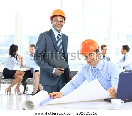 Architects working on construction project - stock photo