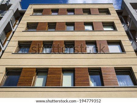 Architectural background of a modern apartment with wooden facade - stock photo