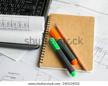 Architectural blueprint of office building with a pencil ,notebook
