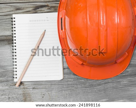 Architectural blueprint of office building with a pencil on wood background - stock photo