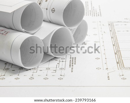 Architectural blueprint of office building with a pencils - stock photo