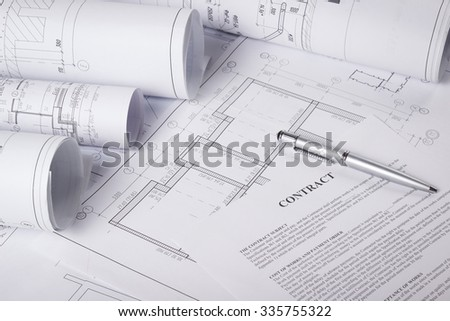 Architectural blueprints and blueprint rolls. - stock photo