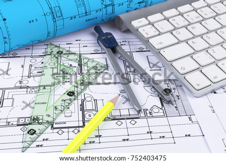 Architectural blueprints drawings modern house computer stock photo architectural blueprints drawings of the modern house with computer keyboard architectural blueprints and blueprint rolls malvernweather Gallery