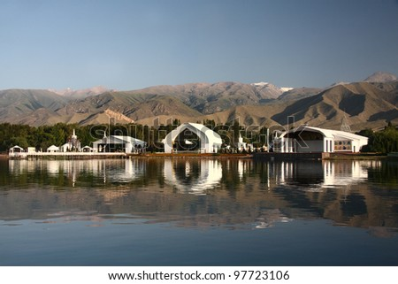 Architectural complex on  bank of mountain lake. Kyrgyzstan. Lake  issyk-kul. - stock photo