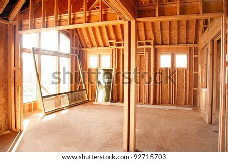 Architectural construction framework under bright blue sky