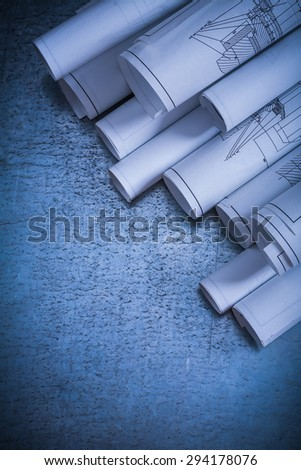 Architectural construction plans on scratched vintage silver-metal surface building and architecture concept. - stock photo