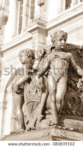 Architectural detail of cherub figures on lamppost at entrance to the City Hall of Paris - stock photo