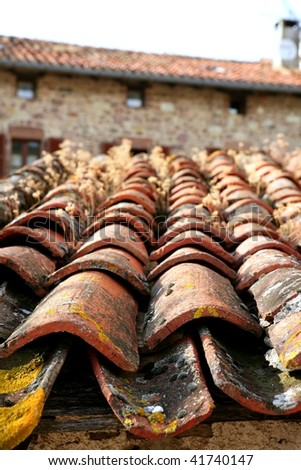 Architectural detail of grunge aged roof clay tiles - stock photo