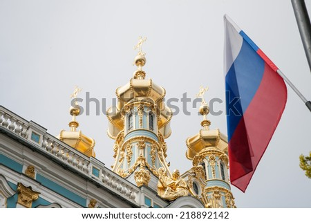 Architectural detail of hermitage in St Petersburg with Russian flag