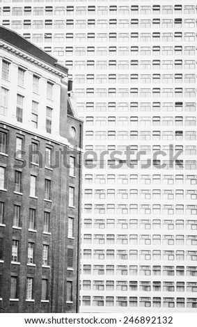 Architectural detail showing the contrast between older and newer architecture - stock photo