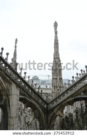 Architectural details from the roof of Milan Cathedral (Duomo di Milano) built in Gothic style. - stock photo