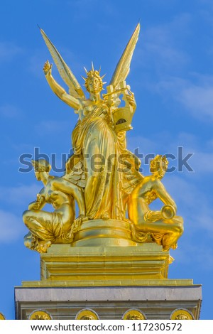 Architectural details of Opera National de Paris: Harmony roof sculpture by Charles Gumery. Grand Opera (Garnier Palace) is famous neo-baroque building in Paris, France - UNESCO World Heritage Site. - stock photo