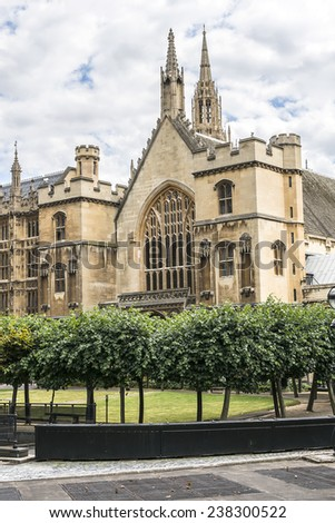 Architectural details of Palace of Westminster (known as Houses of Parliament) located on bank of River Thames in City of Westminster, London. View from the courtyard of House of Parliament - stock photo