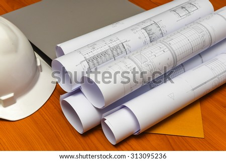 Architectural drawings paper on the table office - stock photo