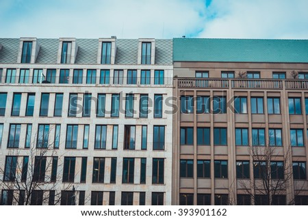 Architectural Exterior of Modern Low Rise Commerical Office and Residential Apartment Building Facades in Varying Styles in Urban Berlin, Germany