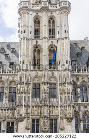 Architectural fragment of Town Hall (Hotel de Ville) on Grand Place (Grote Markt) - central square of Brussels - most important tourist destination and most memorable landmark in Brussels, Belgium.