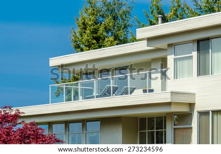 Architectural fragment: side of the modern  house with the balcony and windows. - stock photo
