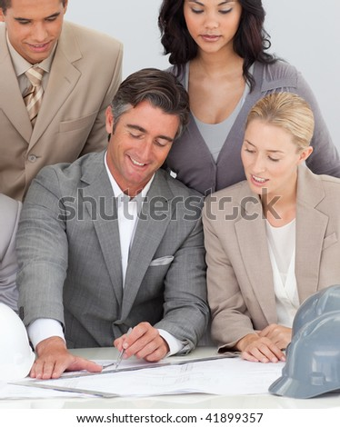 Architectural multi-ethnic business team working in the office - stock photo