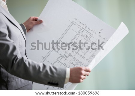 architectural plan in the hands of an architect  - stock photo