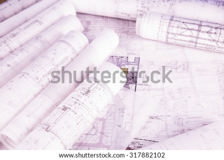 Architectural project and Yellow helmet and house model - stock photo