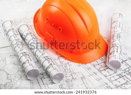 Architectural rols and helmet - stock photo