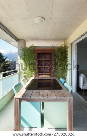 Architecture, balcony with table and chairs