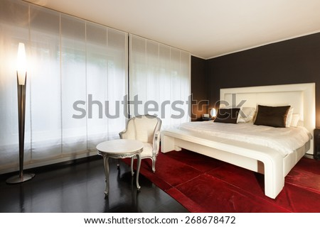 Architecture, beautiful apartment furnished, comfortable bedroom - stock photo