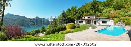 Architecture, beautiful villa with swimming pool, panorama - stock photo