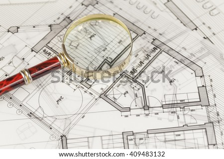 architecture blueprint -  house plans & magnifying glass - stock photo