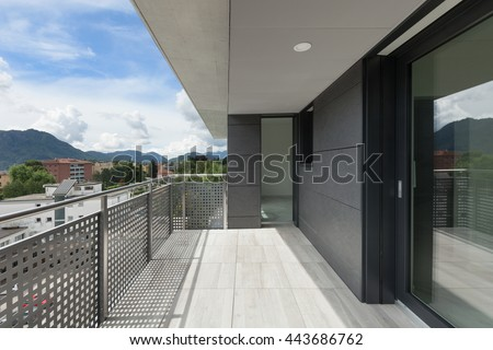 Architecture contemporary, balcony of a building, cloudy sky - stock photo