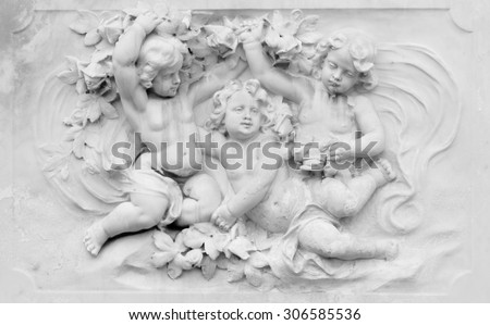 Architecture detail of basrelief with cherubs - stock photo