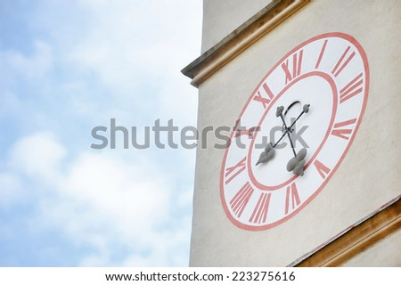 Architecture detail with old church clock tower and blue sky on background - stock photo