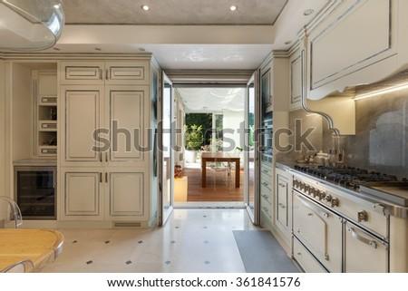Architecture; domestic kitchen in classic style, veranda view - stock photo