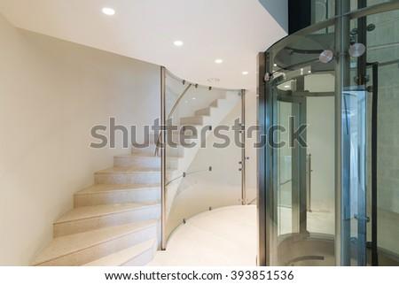 Architecture, futuristic elevator in a modern building - stock photo