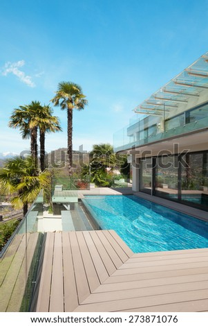 architecture, modern house, beautiful patio with pool, outdoor - stock photo