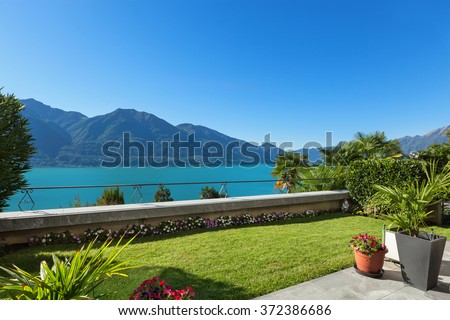 Architecture, nice terrace with green lawn, lake view - stock photo