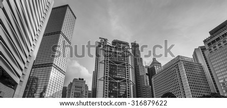 Architecture of Central with Blue Sky Background in Black and White - 6 Sep 2015: It include the Standard Chartered Bank Building, Prince's Building, Cheung Kong Center and HSBC Hong Kong Headquarter.