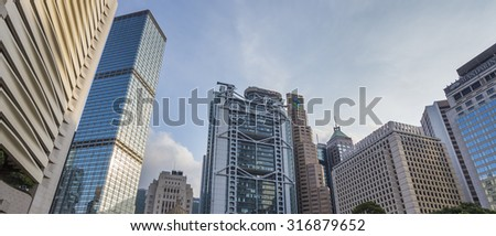 Architecture of Central with Blue Sky Background - 6 Sep 2015: It include the Standard Chartered Bank Building, Prince's Building, Cheung Kong Center and HSBC Hong Kong Headquarter.