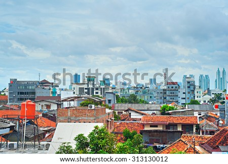 Architecture of Jakarta from suburb to downtown. Indonesia - stock photo