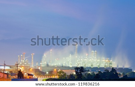 Architecture of Oil Refinery Plant with Power Generator with Sunrise Twilight - stock photo
