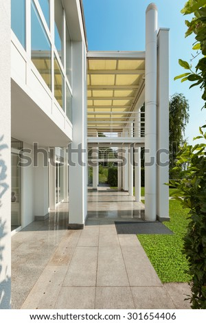 Architecture, porch of a modern house, exterior - stock photo