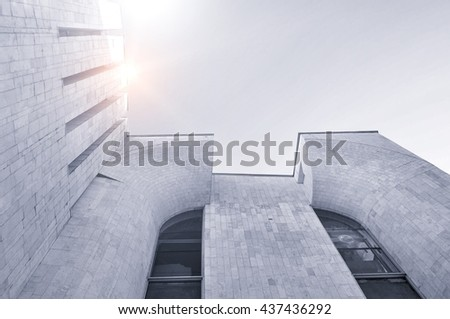Architecture urban background - perspective bottom view of high building architecture details of concrete and glass . Black and white tones applied. Architecture futuristic cityscape. - stock photo