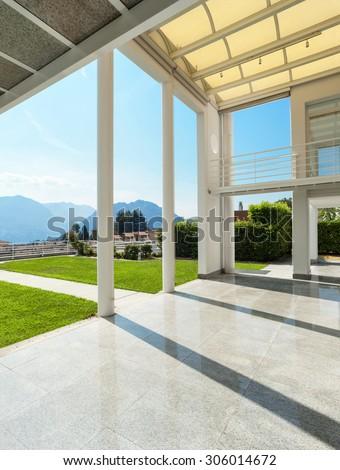 Architecture, wide veranda of a modern house, exterior - stock photo