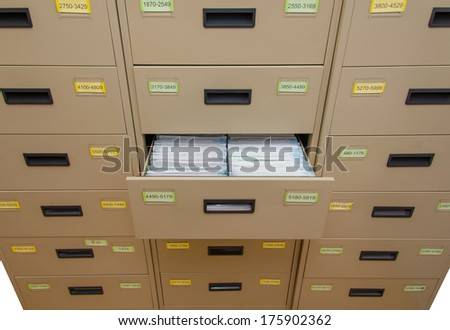 Archive cabinet with open drawer. - stock photo