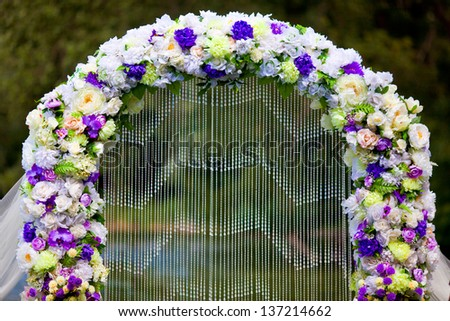 archway of many beautifil flowers - stock photo