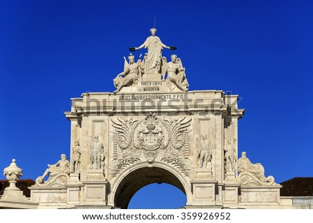 Arco da Rua Augusta with statues and blue sky, Lisbon, Portugal