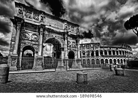 Arco di Costantino (Arch of Constantine) and Colosseum, Roma, Italy.