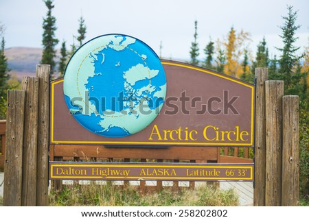 arctic circle sign, Dalton Highway, Alaska in fall - stock photo